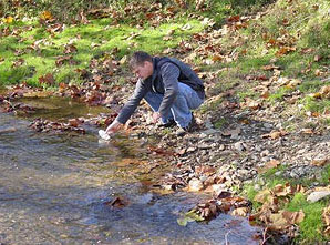 Figure 4. Taking a water sample for analysis.
