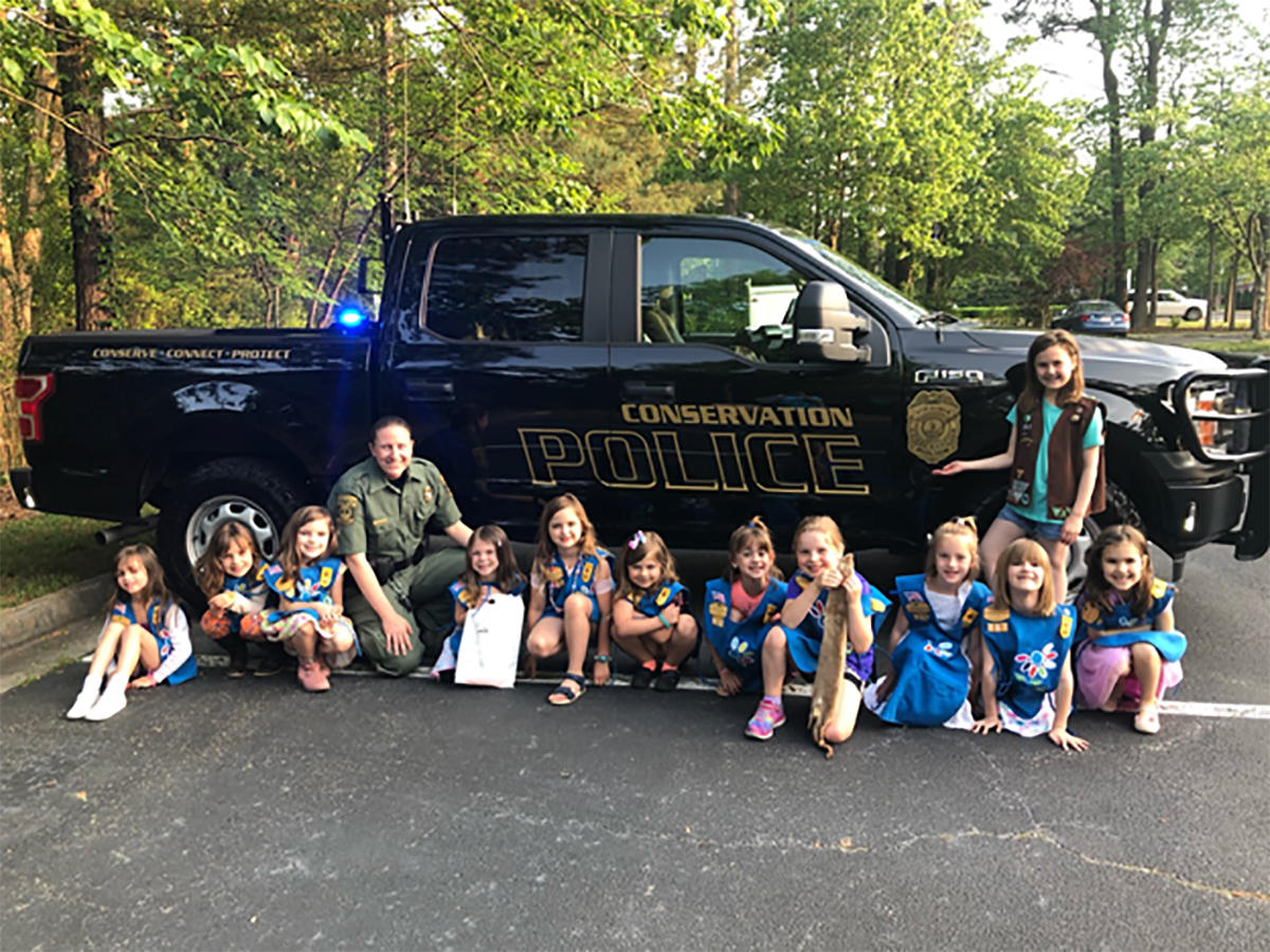 CPO Bonnie Braziel (fourth from left) meeting with a Girl Scout troop. Photo courtesy of Bonnie Braziel