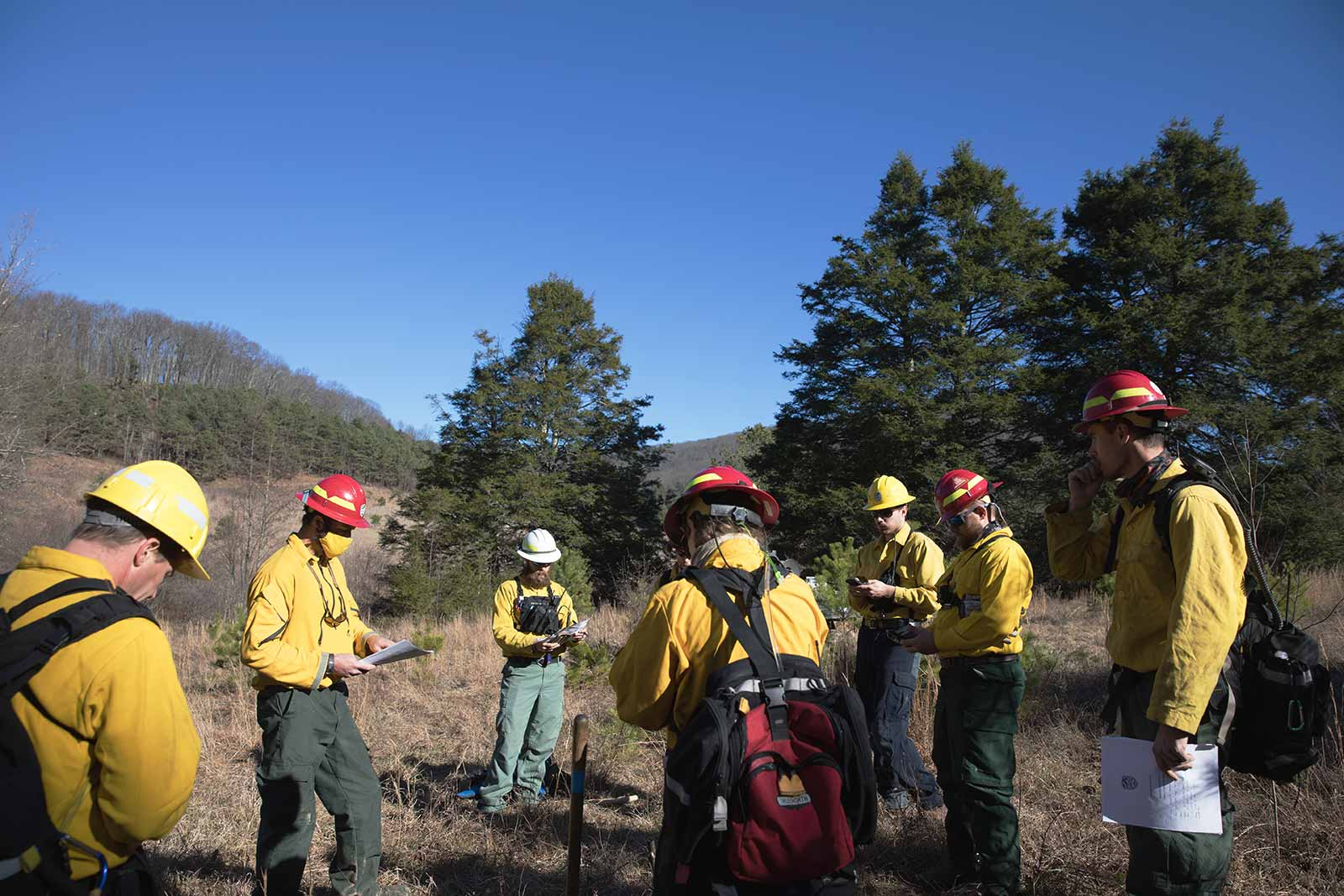 A fire crew meets to go over the day's prescribed burn plan.